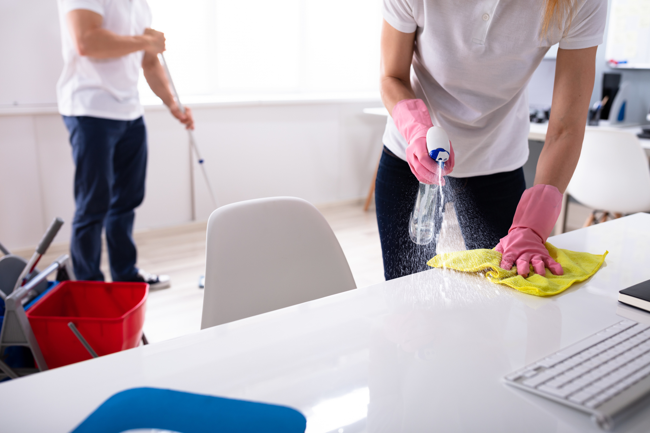 Two Young Janitor Cleaning The Office